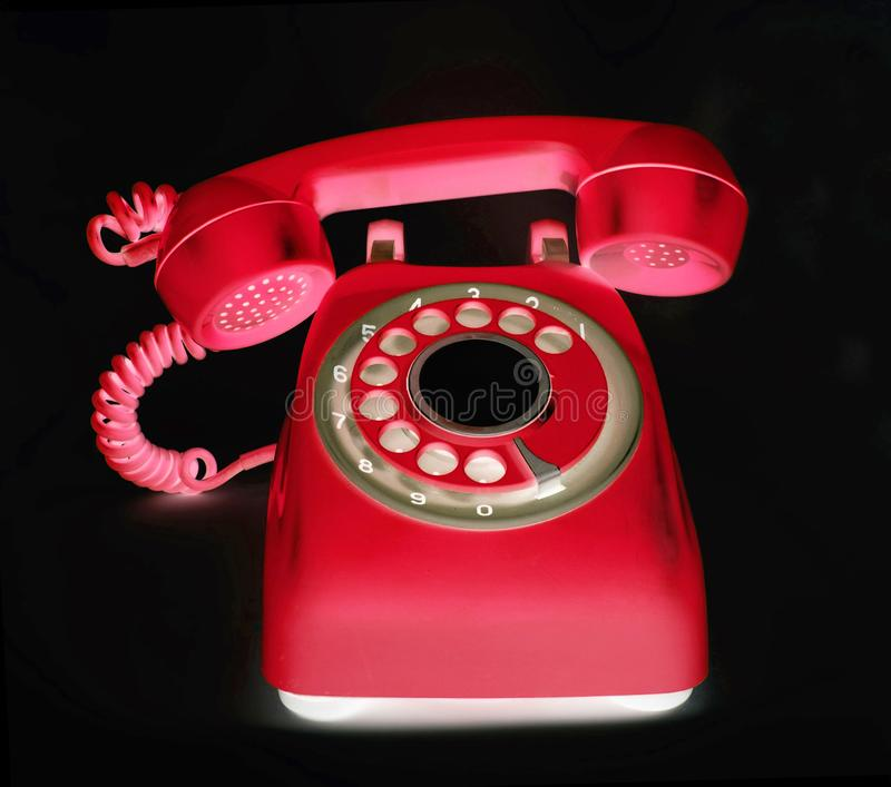 Old red phone ringing of the hook royalty free stock photos