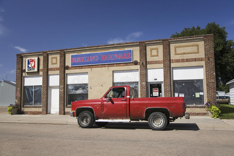 Old red pickup truck. Stopped in front of old-time Hardware store in Big Springs, Nebraska, on the Lincoln Highway, US 30 royalty free stock photography