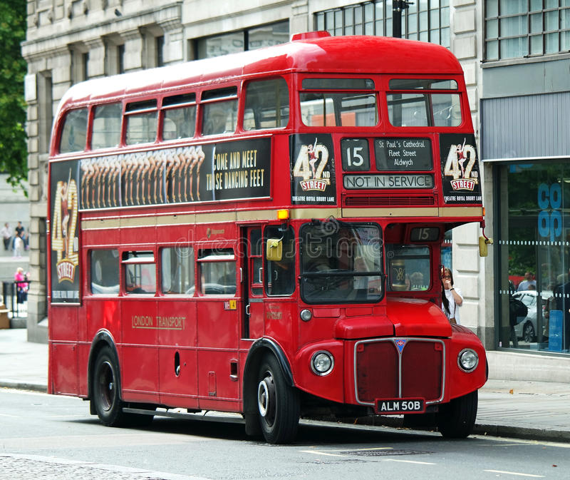 Old red routemaster London bus. An old Routemaster bus parked on a street in London stock photos