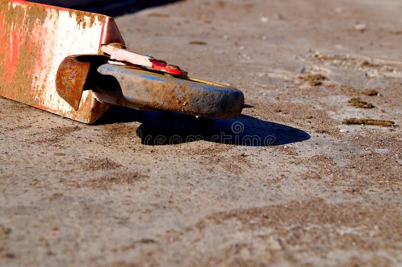 Old red rusty abandoned scooter lying on the concrete floor. Childrens transport royalty free stock images