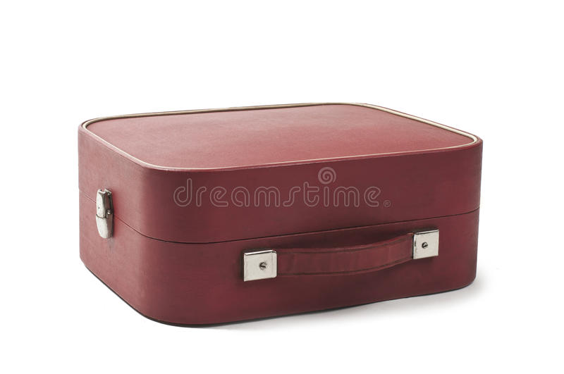 Old red suitcase isolated on white background stock photo