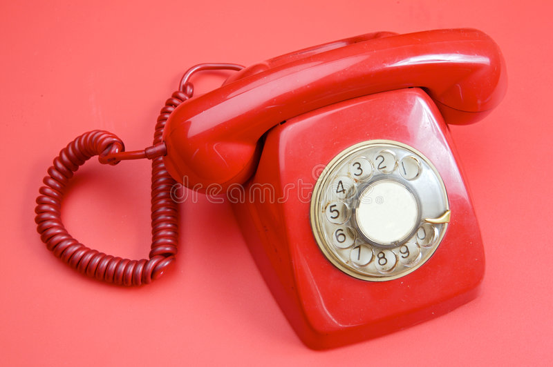 Old red telephone royalty free stock image