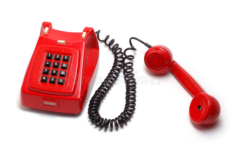 Old red telephone. On white background royalty free stock images