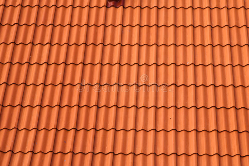 Old red tile roof. A background stock photo