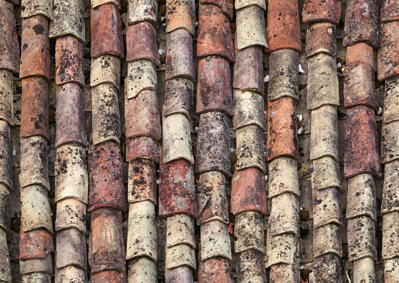 Old red tile roof background. Texture stock photography