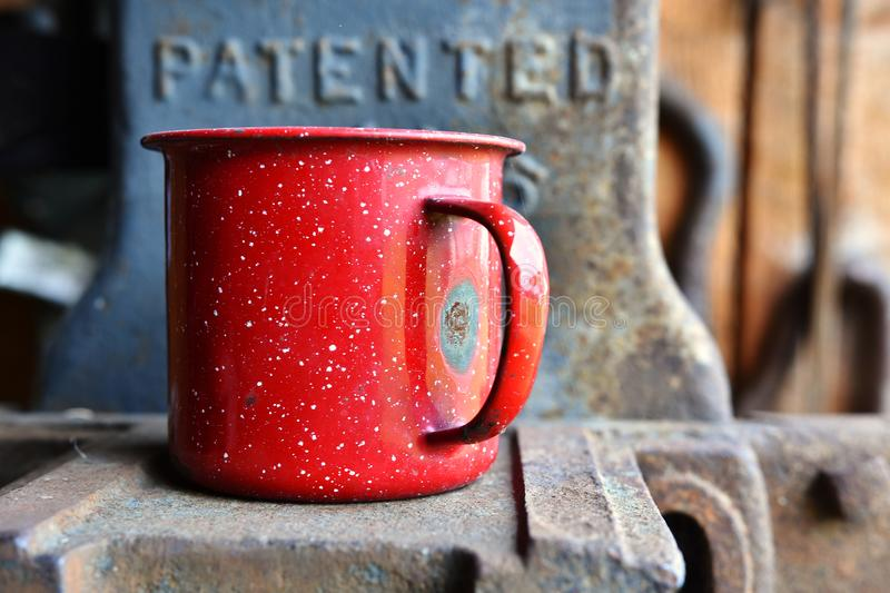 Old Red Tin Coffee Mug royalty free stock images