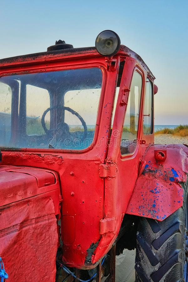 Old red tractor at the beach. Ahlbeck, Germany stock image