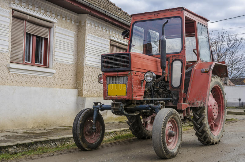Old red tractor. Ready for work stock photos