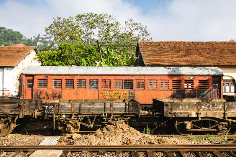 An old red train car sits abandoned in Kandy railway station, Sr royalty free stock photo