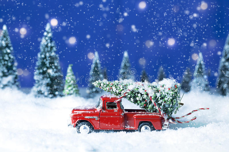 Old Red Truck With Christmas Tree A Miniature Replica Pickup Driving Through Snow