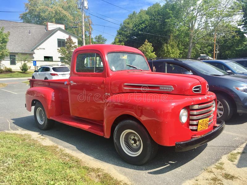 Old red vintage pick-up truck Ford royalty free stock photo