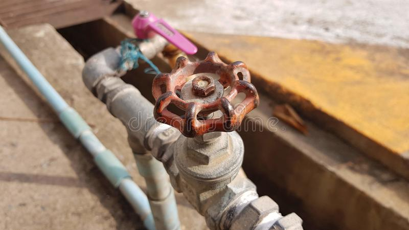 Old red water valve royalty free stock photography