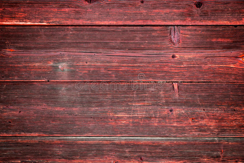 The old red wood texture with natural patterns. Old red wood texture with natural patterns royalty free stock photos