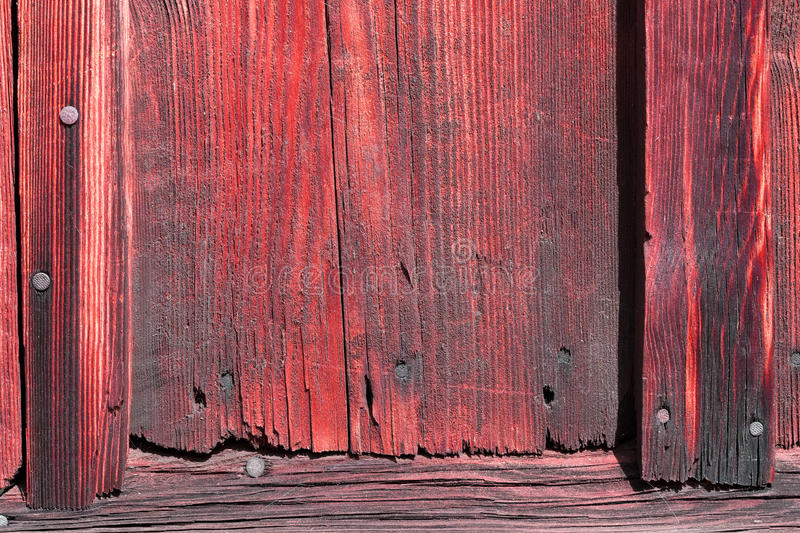 The old red wood texture with natural patterns. Old red wood texture with natural patterns stock photography
