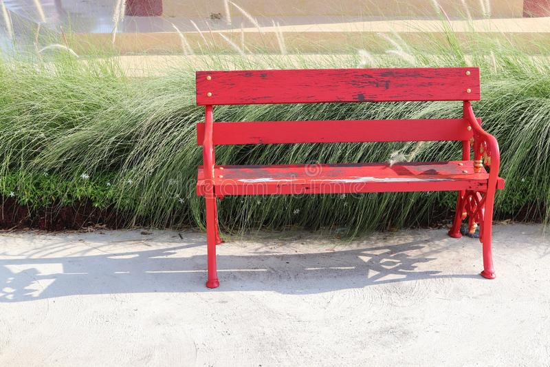 Old red wooden bench in the garden stock image