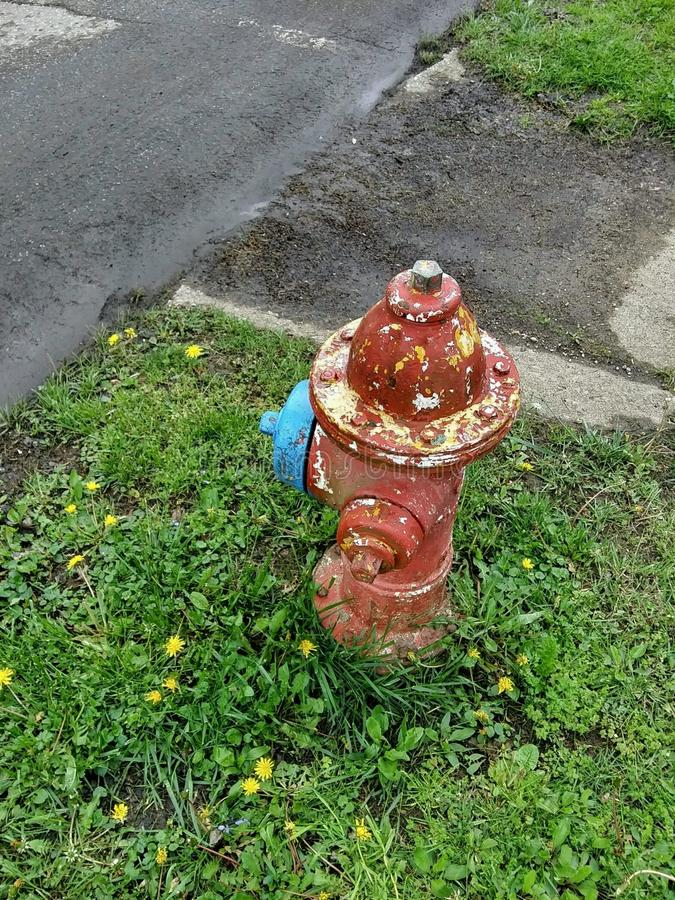 Old Red Yellow Blue Fire Hydrant Antique royalty free stock photos