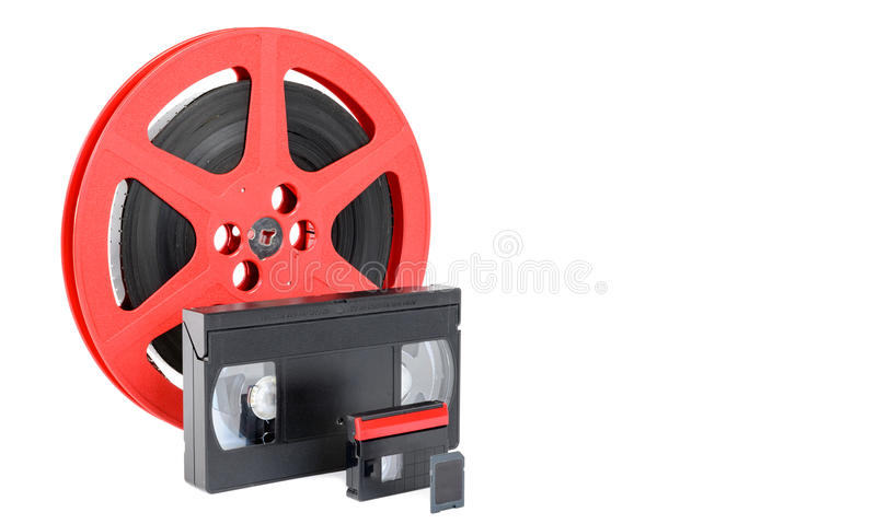 Old reel of film, video tape and memory card royalty free stock photos