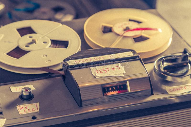 Old reel-to-reel tape recorder with microphone and roll of tape royalty free stock images