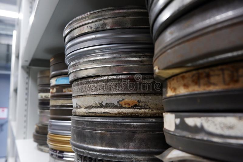 Old reels of film in silver cans stock photography