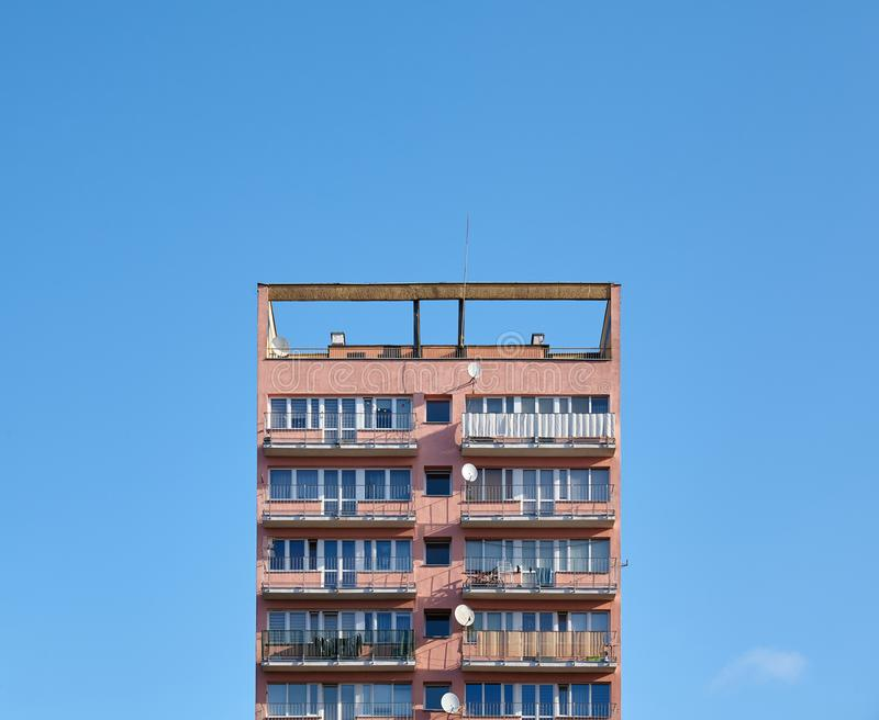 Old residential building against the blue sky stock photo