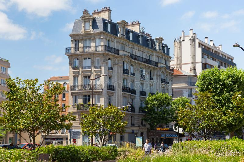 PARIS, FRANCE - JUNE 23, 2017: Old residential buildings in historic part of Paris at summertime. Old residential buildings in historic part of Paris at royalty free stock photos