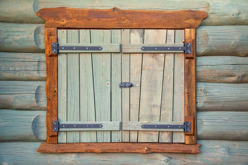 Old and restored  shutter. Old and restored log house shutter close up stock photography