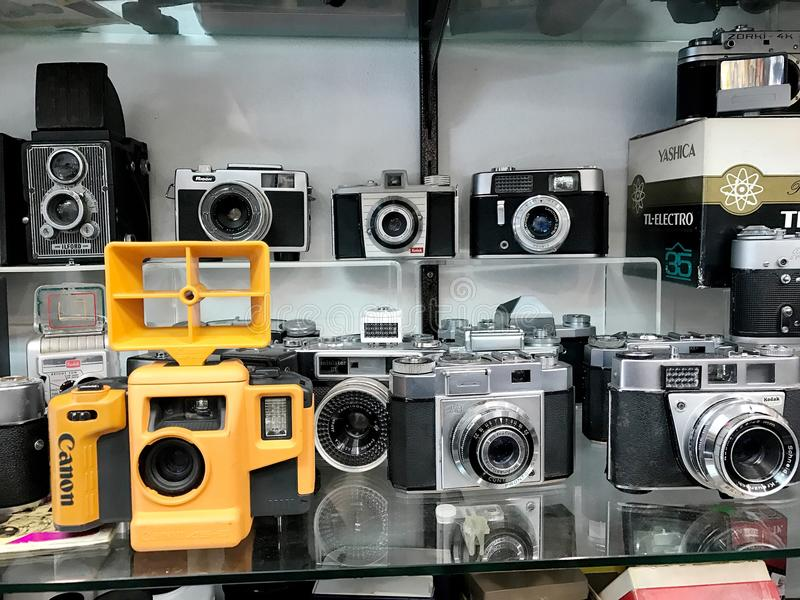 Old retro aged equipment, photo, film cameras in shop-window. royalty free stock images