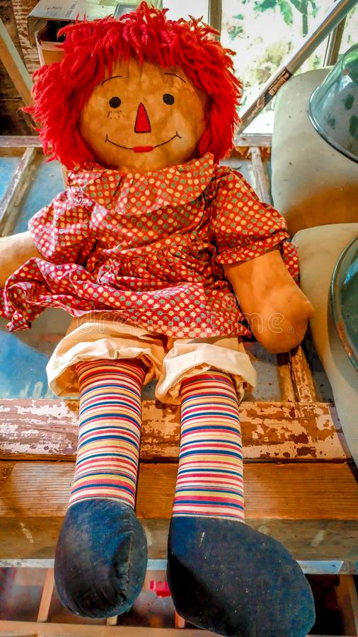 Old Doll Toy with Red Hair stock photography