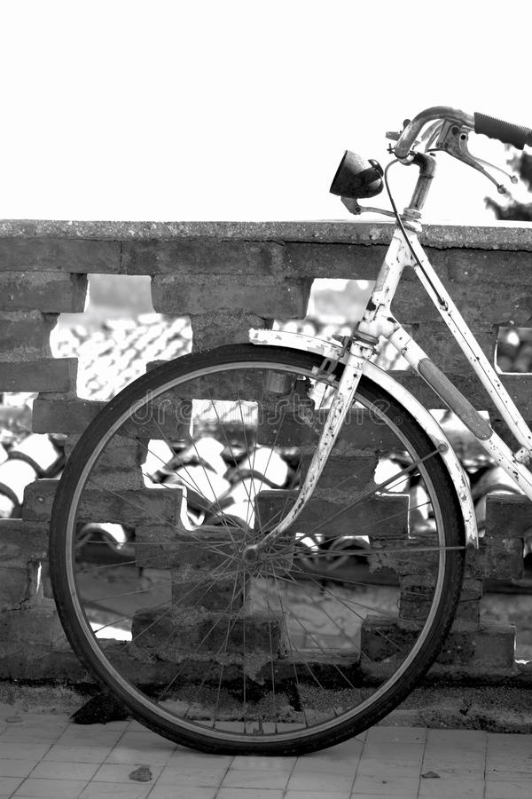 Old retro bicycle against a wall in Italy stock photos