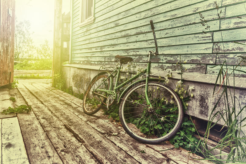 Old retro bike. In the house in the village royalty free stock photo