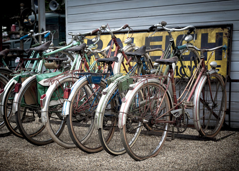 Old retro bikes. A group of old rusty retro push-bikes parked in a row royalty free stock images
