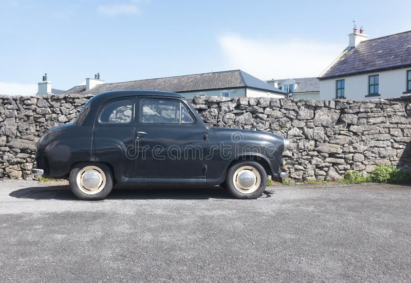 Old retro British car, UK village. Old retro black British car, UK village royalty free stock photo