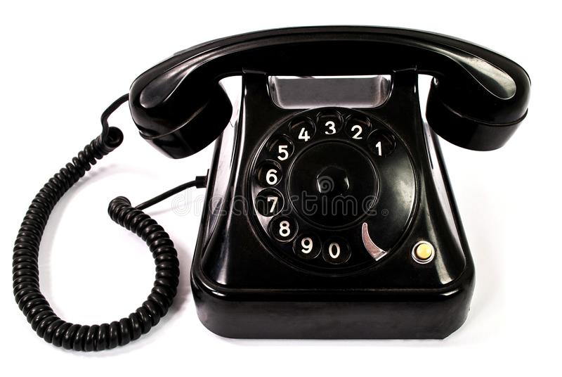 Old retro black phone isolated on a white background stock photos