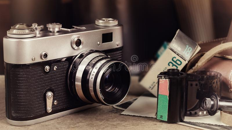 Old film camera on wooden table. royalty free stock images