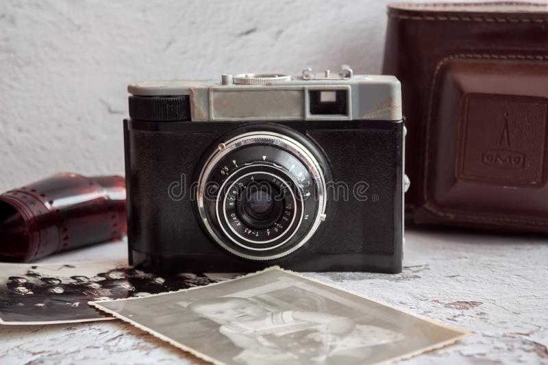 Old retro camera with old photos. Old photos from the past, retro camera old shots, memories royalty free stock photography