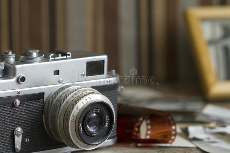 Old retro camera with pictures abstract background stock images