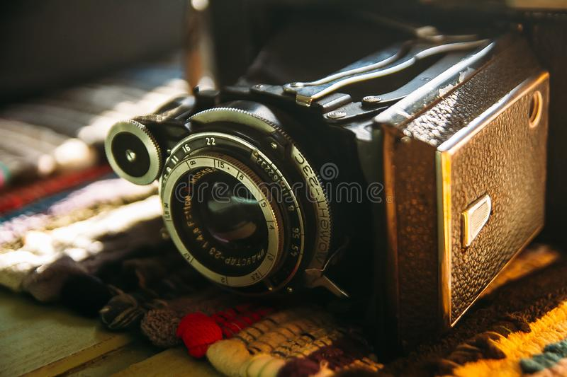Old retro camera. Vintage still life. Vintage background. Krasnodar, Russia - January 18, 2019: Old Russian camera Moment - 23c with Industar 23 lens royalty free stock photography