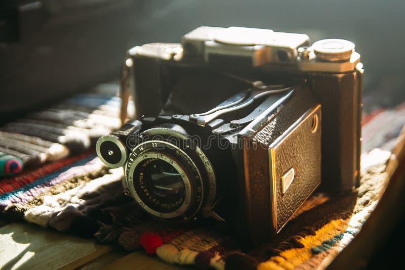Old retro camera. Vintage still life. Vintage background. Krasnodar, Russia - January 18, 2019: Old Russian camera Moment - 23c with Industar 23 lens stock images