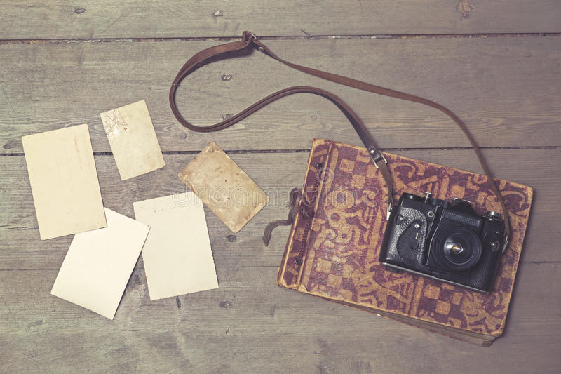 Old retro camera withvintage photo album and blank pictures royalty free stock photo
