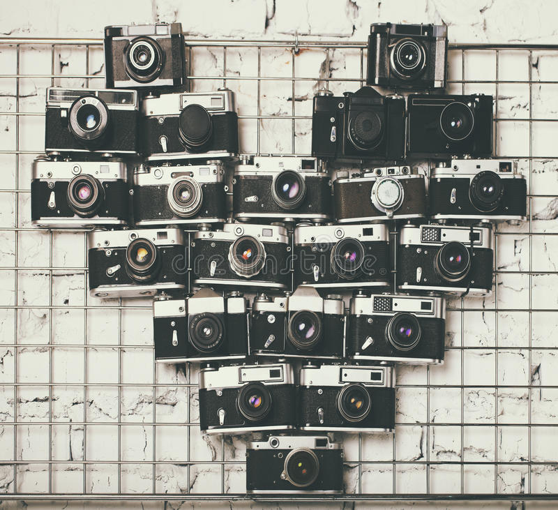Old retro cameras in heart love photography shape stock image