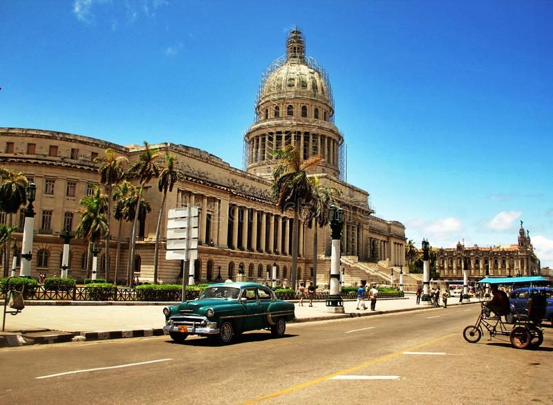Old retro car in Havana,Cuba. HAVANA,CUBA-MAY 04.2013 Old retro classic american car and Capitol building in Havana,Cuba Photo taken on: May 4, 2013 royalty free stock photography