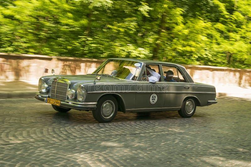 Old retro car  Mercedes- Benz 220 SE 1963. Lviv, Ukraine - June 2, 2019: Old retro car Mercedes- Benz 220 SE 1963  with its owner and  unknown passenger taking stock image