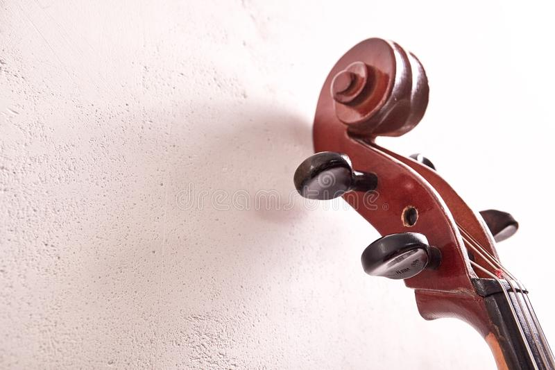 Old retro cello. In room. Music background stock images