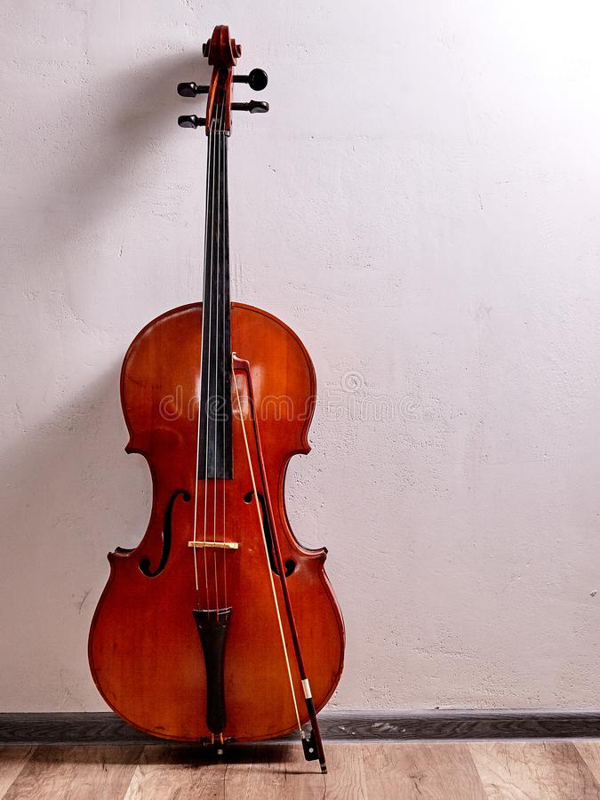 Old retro cello. In room. Music background royalty free stock images