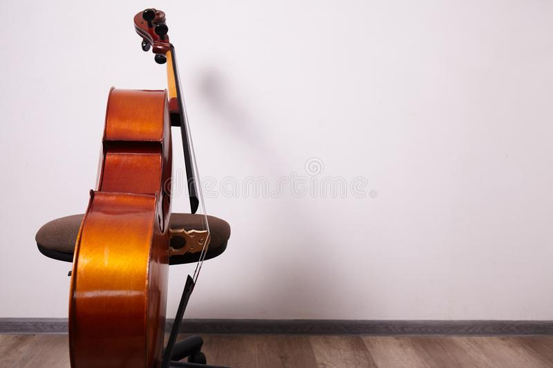 Old retro cello. In room. Music background stock photos