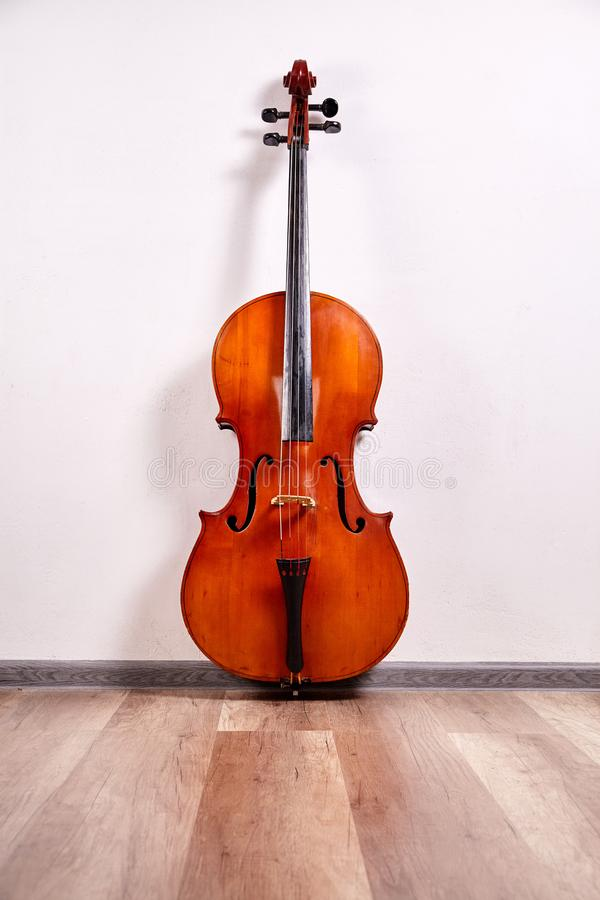 Old retro cello. In room. Music background stock image