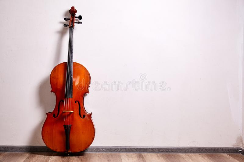 Old retro cello. In room. Music background royalty free stock photos
