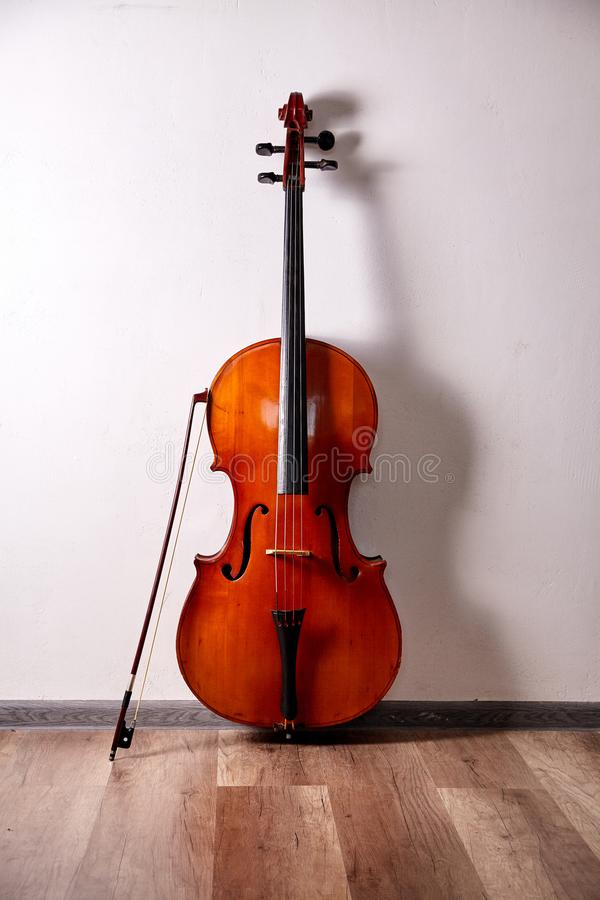 Old retro cello. In room. Music background stock photo