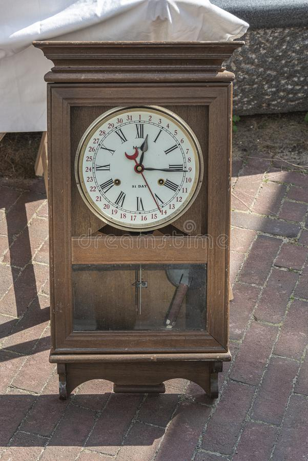 Old retro clock in a brown wooden case royalty free stock images