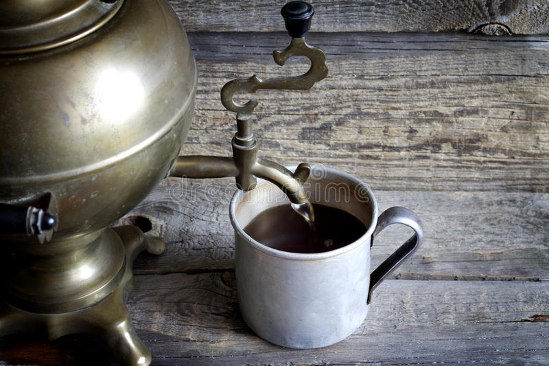 Old retro cup of tea with samovar on vintage table stock images